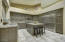 Updated kitchen with Shaker style cabinetry and new stainless steel appliances.