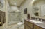Originally the powder room, the owner added the shower area and updated to create a third, full sized bath.