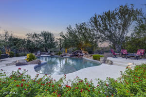 Beautiful pool with water feature, surrounded by lush landscape and NAOS behind for greater privacy.