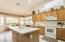 KITCHEN WITH EATING AREA-CORIAN COUNTERS & SINK, KITCHEN ISLAND & RECESSED LIGHTING