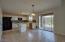 Open kitchen with island & glass sliding door to backyard