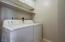 Laundry room conveniently located upstairs