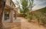 Low maintenance, private backyard with plenty of space & mature landscaping