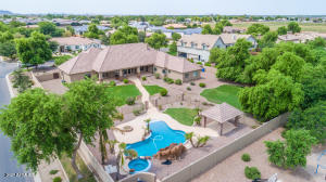 This is your chance to purchase a impeccably updated custom home with a  full GUEST HOUSE in a Circle G Ranch community. This corner lot home sits on just under an acre of manicured grounds with a beachfront heated pool, spa and children's slide. The interior includes all the bells and whistles that you would expect including a chef's kitchen with quartz countertops and  top of the line appliances including a 6 burner gas range, . The brand new flooring includes wood plank look flooring and plush carpeting. The bathrooms all have new custom showers and new sinks & cabinets. The extended back patio has a built-in cooking station w/a BBQ. The 2 bedroom guest house comes fully equipped with a full kitchen, living area, laundry area & separate entrance!  This is a truly unique property!