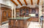 Gourmet kitchen with custom cabinetry, gorgeous rare mable counters.