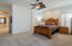 Master with walk in closet inside large bath area.