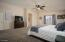Master Bedroom with carpet floors and ceiling fan!