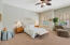 Enormous master bedroom w/ceiling fan and sitting area