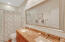 Guest bath with double sinks and tub/shower combo serves bedrooms 3 and 4