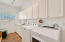 Laundry room with window (rare find) has lots of storage and that coveted utility sink!