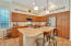 Gorgeous kitchen w/island, recessed & pendant lighting, gas range, pullouts in cabinets & so much more!
