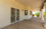 FULL COVERED PATIO, SHOWS FAMILY ROOM DOUBLE DOORS.