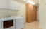 Laundry room. Washer/Dryer and lots of extra cabinets along with more cabinets in the garage!