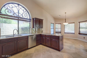 Kitchen with Gorgeous Iron Detail above Window