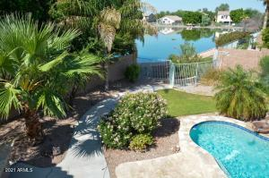 What could be better than a waterfront lot with a decked out back yard with spool, fire pit, outdoor kitchen and more?