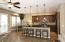 Kitchen features granite counters & custom cabinets.