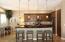 Kitchen island with pendant lighting.