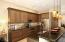 Kitchen has upgraded backsplash, stainless steel appliances.