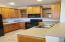 Kitchen Extended Height Cabinets. Corian Counter Tops.