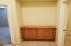Hallway to Master with Storage Cabinet.