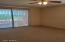 Large Master Bedroom with Slider to Patio and Golf Course Views. Main Floor.