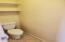 Toilet Room with Door.