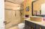 Granite and custom sinks in both bathrooms.