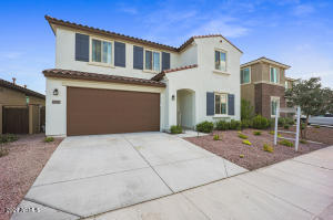 Welcome Home to 21047 W Almeria! OWNED SOLAR in this 5 Bedroom & 3 full bath.