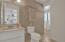 Master bath that is open to the master and the tiled area off of back door so that you have easy access from pool