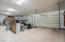 Extended depth 4 car garage with workspace and storage!!