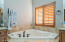 Jetted corner tub with amazing natural light!
