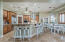 Open concept kitchen with bar and eat-in nook