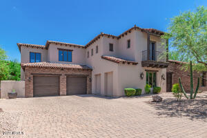 """Gorgeous """"villa"""" style home with 3 car tandem garage. Cobbled stone driveway."""