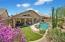 Back Elevation with turf, covered patio, and sparkling pool