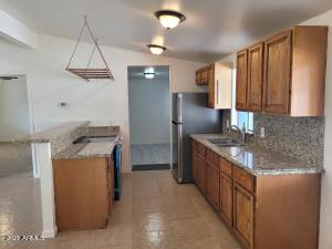 Kitchen with Granite Countertops and hanging pot holder