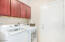 Washer and Dryer Convey! Custom built in cabinets utilize this space perfectly!