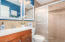 Full renovation with designer tile shower surround, new cabinetry, and new countertops.