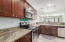 Kitchen with stainless appliances and granite counters. Lots of counter space and storage!