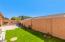 Nice backyard with natural grass.