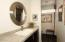 UPDATED HALL BATH W/ CUSTOM CABINETRY FOR LINENS