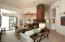 LIVING & DINING ROOMS SHARE MAGNIFICENT STONE FIREPLACE AND PATIO ACCESS.