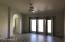 Large Master Bedroom with french doors leading to backyard patio