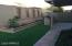 Newly landscape backyard with large artificial grass