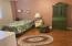 Designer paint colors and wood laminate flooring.