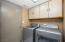 Direct entry from the garage into the laundry room. Washer/Dryer convey with the sale.