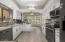 The kitchen boasts wide walkways, newer appliances, and a light and bright breakfast room.