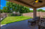 Covered, North Facing Patio and Natural Grass Yard beyond.
