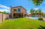 Large, Natural Grass Backyard and Safety Fence surrounding the Pool.