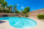 Sparkling, Kidney Shaped Pool with Natural Stone Water Feature.