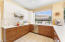 Large U- Shaped Kitchen with Custom Cabinets and Quartz Counters.